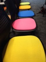 Multi-coloured chairs in Google HQ, London
