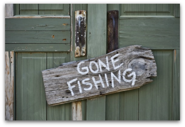 Gone fishing sign on a wooden plaque